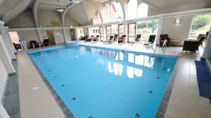Indoor pool, open 7:30 AM to 9:00 PM, pool loungers