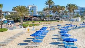 On the beach, sun loungers, beach umbrellas