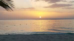 Private beach, white sand, sun loungers, beach bar