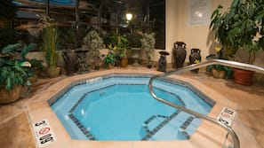 Indoor pool, open 7 AM to 11 PM, pool umbrellas, sun loungers