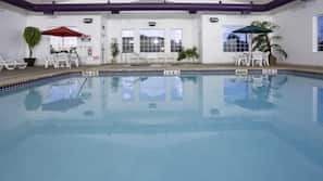 Indoor pool, open 6:00 AM to 11:00 PM, pool umbrellas