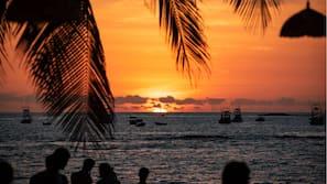 On the beach, beach towels, beach massages, beach bar