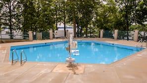 Seasonal outdoor pool, open 10:00 AM to 7:00 PM, sun loungers