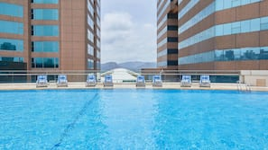 Seasonal outdoor pool, open 6:00 AM to 10:00 PM, pool umbrellas