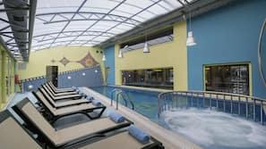 Indoor pool, outdoor pool, open 8 AM to 7 PM, pool umbrellas