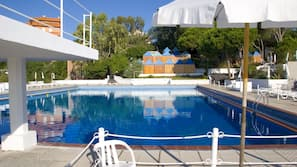 2 outdoor pools, open 9 AM to 7 PM, pool umbrellas