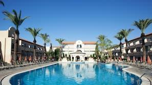 Indoor pool, seasonal outdoor pool, open 9 AM to 7 PM, free pool cabanas