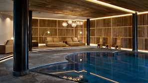 Indoor pool, pool umbrellas, sun loungers
