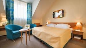 Ropa de cama hipoalergénica, minibar, escritorio y cortinas opacas