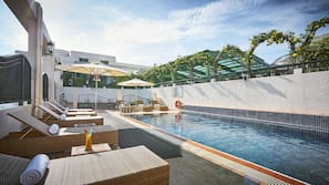 Outdoor pool, open 6:00 AM to 10:00 PM, pool umbrellas, pool loungers