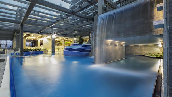 4 indoor pools, outdoor pool, open 7 AM to 9 PM, lifeguards on site