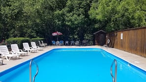 Seasonal outdoor pool, open 10:00 AM to 10 PM, pool umbrellas