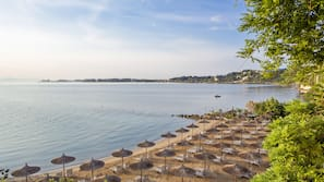 Private beach, sun loungers, beach umbrellas, beach volleyball