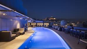 Seasonal outdoor pool, open 10 AM to 6 PM, pool umbrellas, sun loungers