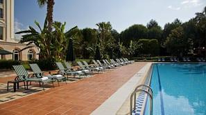 Indoor pool, outdoor pool, pool umbrellas, sun loungers