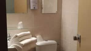 Deep-soaking bathtub, free toiletries, hair dryer, towels