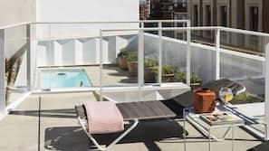 Seasonal outdoor pool, open noon to 9 PM, pool umbrellas, pool loungers