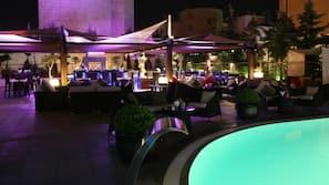 Seasonal outdoor pool, open 7:30 AM to 6:00 PM, pool umbrellas