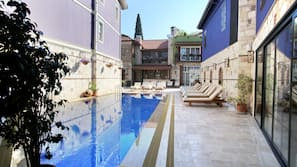 Outdoor pool, open 9 AM to 6 PM, pool umbrellas, pool loungers