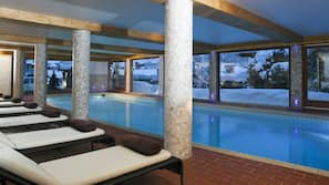 Indoor pool, open 10 AM to 8 PM, pool loungers