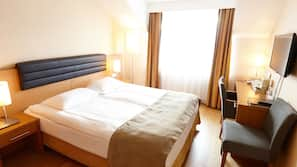 Hypo-allergenic bedding, in-room safe, blackout curtains