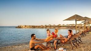 On the beach, beach umbrellas, beach massages, snorkelling
