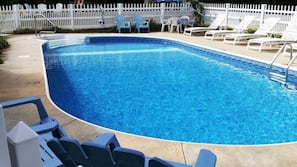 Seasonal outdoor pool, open 10:00 AM to 8 PM, pool loungers