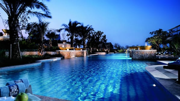 Outdoor pool, open 6:30 AM to 9 PM, free cabanas, pool umbrellas