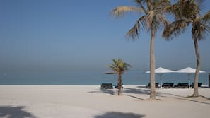 On the beach, beach cabanas, sun-loungers, beach umbrellas