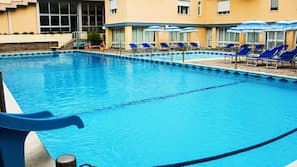 Seasonal outdoor pool, open 9:00 AM to 6:30 PM, pool umbrellas