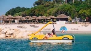 On the beach, free beach cabanas, sun-loungers, beach volleyball