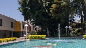 Outdoor pool, open 9 AM to 8 PM, pool umbrellas