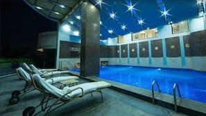 Indoor pool, seasonal outdoor pool, free pool cabanas, pool loungers
