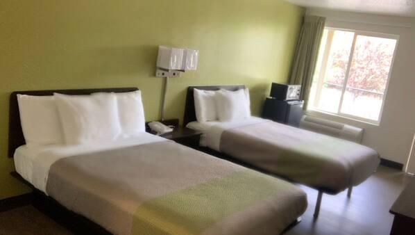 Premium bedding, Select Comfort beds, desk, blackout drapes