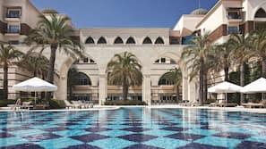 2 indoor pools, 2 outdoor pools, open 7:00 AM to 7:00 PM, pool umbrellas