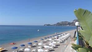 Private beach, black sand, beach umbrellas