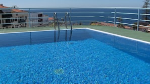 Outdoor pool, open 9:30 AM to 7:30 PM, pool loungers