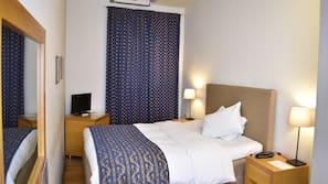 Luxe beddengoed, donzen dekbedden, pillowtop-bedden, een minibar