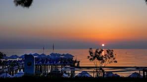 Private beach, black sand, sun loungers, beach umbrellas
