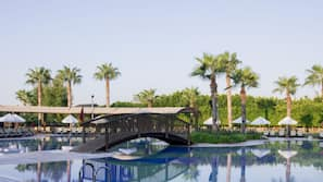 Indoor pool, 7 outdoor pools, open 7:00 AM to 7:00 PM, sun loungers