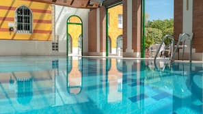 Indoor pool, open 9:00 AM to 9:00 PM, pool loungers