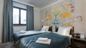 Sengetøy av topp kvalitet, memory foam-senger, minibar og safe på rommet
