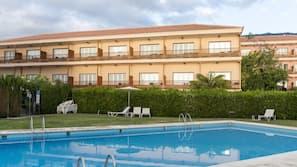 Seasonal outdoor pool, open 1:30 PM to 5:30 PM, pool umbrellas