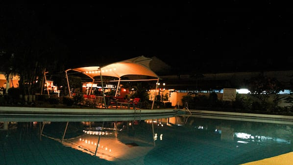 Outdoor pool, open 6:00 AM to 6:00 PM, pool umbrellas, sun loungers