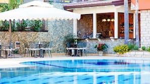 Indoor pool, 2 outdoor pools, open 10:00 AM to 7:00 PM, pool umbrellas