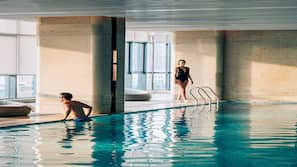 Indoor pool, open 9:30 AM to 8:00 PM, pool loungers