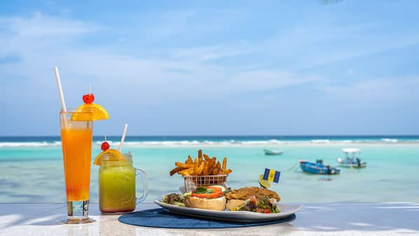 Breakfast, lunch and dinner served, Caribbean cuisine, pool views