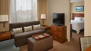 27-inch TV with cable channels, pay movies, MP3 dock