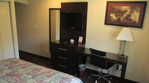 Desk, blackout drapes, iron/ironing board, rollaway beds