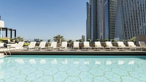 2 outdoor pools, open 7:00 AM to 8:00 PM, pool loungers